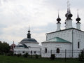 The three churches of suzdal golden ring russia in in summer domes with crosses on background sky Stock Photography