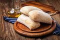 Three ciabatta bread buns. Royalty Free Stock Photo