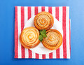 Three cinnamon rolls on white plate Royalty Free Stock Images