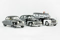 Three classic vintage miniature cars, one police car, Scale models.