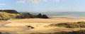 Three cliffs bay panorama a panoramic view of the vast expanse of on the gower peninsula in south wales uk Royalty Free Stock Image