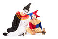 Three clowns doll clown girl clown and adult pierrot isolated on white Stock Photography