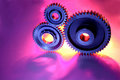 Three cogs Stock Images