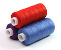 Three coils of threads blue red and violet on a white background Royalty Free Stock Image