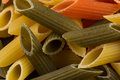 Three color penne pasta tomato spinach and wheat pastas in horizontal format Royalty Free Stock Photos