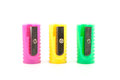 Three colored pencil sharpeners yello pink green Royalty Free Stock Image