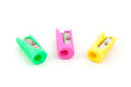 Three colored pencil sharpeners yello pink green Royalty Free Stock Photos
