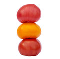 Three colored tomato tomatoes red yellow pink Stock Photos