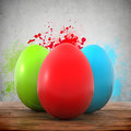 Three colorful eggs on a wooden planks Stock Photography