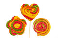 Three colorful lollipops in the shape of heart flower and spiral Royalty Free Stock Image