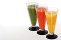 Three colorful smoothie diagonally above different refreshing healthy drinks Royalty Free Stock Image