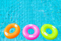 Three colorful swimming pool rings on the water Royalty Free Stock Photos