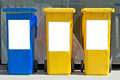 Three colorful trash cans Stock Photography
