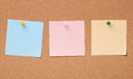 Three colors paper notes on cork board Royalty Free Stock Photo