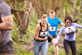 Three competitors running in a forest at an endurance event Royalty Free Stock Photos
