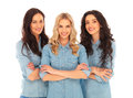 Three confident casual women standing with hands crossed Royalty Free Stock Photo