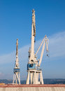 Three cranes in a shipyard sunny day Royalty Free Stock Photography