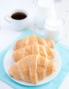 Three croissants with coffee on the white table and milk background Royalty Free Stock Photos