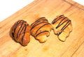 Three croissants on a wooden board Royalty Free Stock Photo
