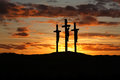 Three crosses over bright sunset with copy space Royalty Free Stock Photo
