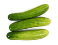 Three cucumber white background Stock Images