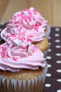 Three Cupcakes with Pink Icing and Sprinkles Royalty Free Stock Photography