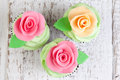 Three cupcakes with roses decorated Stock Image
