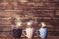 Three cups on coffee on wooden table Stock Photo