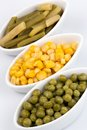 Three cups of corn green peas and beans Stock Photography