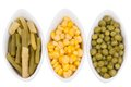 Three cups of corn green peas and beans isolated on white background Royalty Free Stock Photo