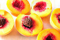 Three cut peaches Stock Photography