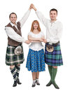 Three dancers in clothing for Scottish dance Royalty Free Stock Photo