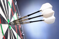 Three darts in bullseye Stock Photos