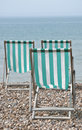 Three Deckchairs Facing Sea Stock Image