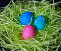 Three decorated easter eggs on plastic grass Stock Photos
