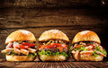 Three delicious chicken, beef and seafood burgers Royalty Free Stock Photo