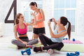Three delighted women checking their training results in gym Royalty Free Stock Photo