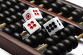 Three dice on abacus are symbolic of gambling and business finance Royalty Free Stock Image