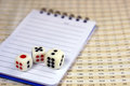 Three dices with notepad Royalty Free Stock Image
