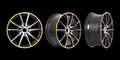 Three different angles rims in a black background Royalty Free Stock Image
