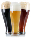 Three different beer with foam beers in glass isolated on a white background Royalty Free Stock Photo
