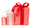 Three different boxes decorated with ribbon isolated on white Stock Photo