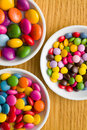 Three different sizes of colorful candies Stock Image