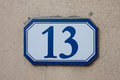 Three dimensional house number thirteen black lettering on a white background Royalty Free Stock Images