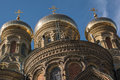 Three domes of naval cathedral over clear blue sky st nicholas orthodox in liepaja latvia close up golden sunny early spring day Stock Photography
