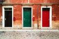 Three doors and three mailboxes Royalty Free Stock Photo