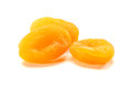 Three dried apricots on white Royalty Free Stock Photo