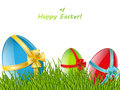 Three easter eggs in green grass Royalty Free Stock Image