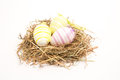 Three easter eggs straw white background Royalty Free Stock Photos