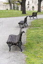 Three empty benches in the park Royalty Free Stock Photo